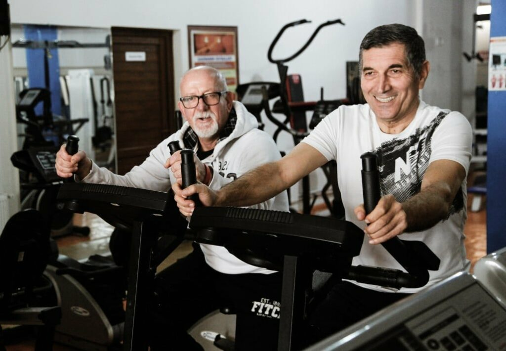 Senior people working in the gym. Old people doing exercises. Having fun in the gym.